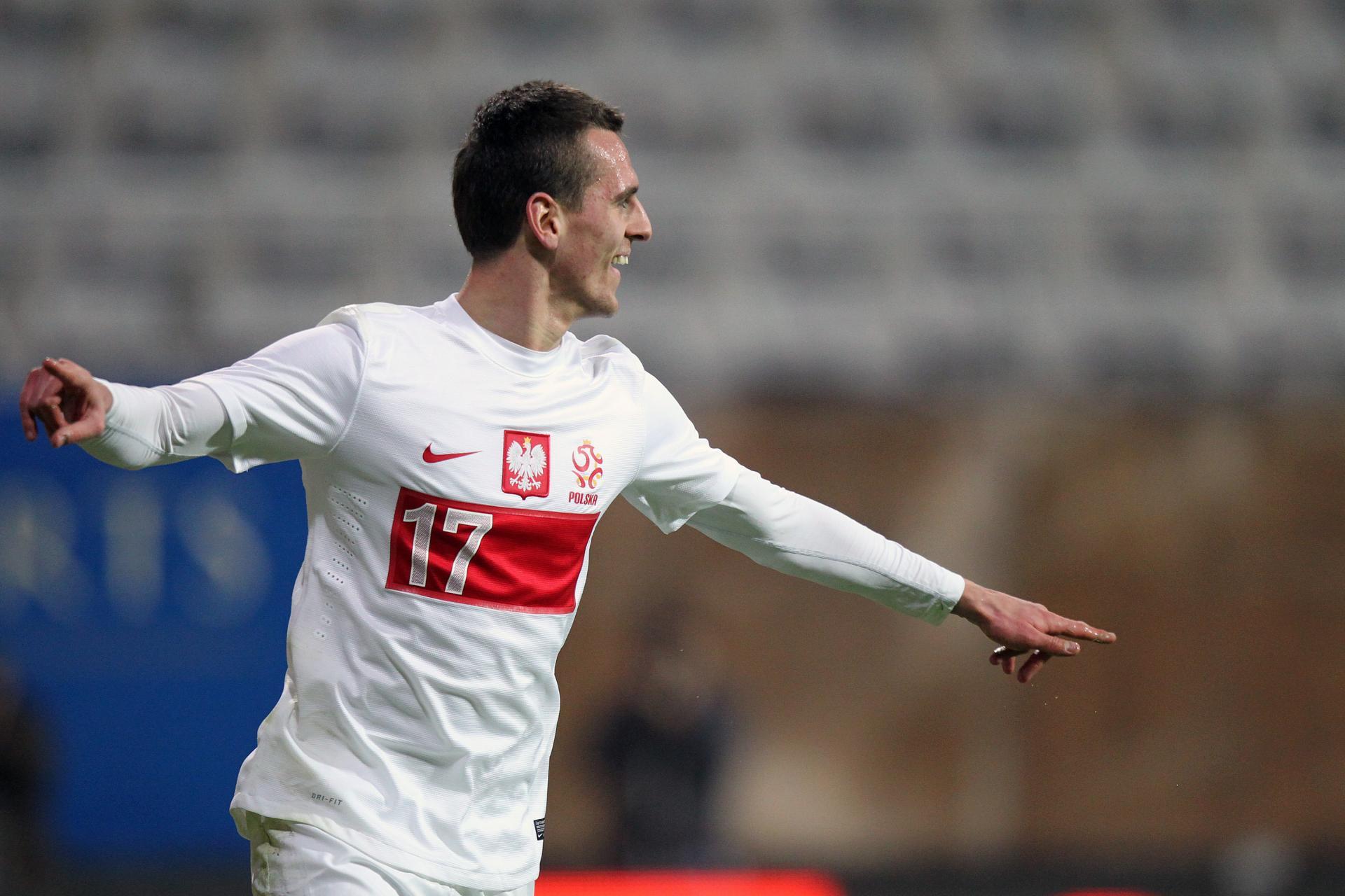 Arkadiusz Milik po strzeleniu swojego pierwszego gola w reprezentacji. Trzy dni później piłkarz Górnika Zabrze zmienił barwy klubowe – stał się zawodnikiem Bayeru Leverkusen.
